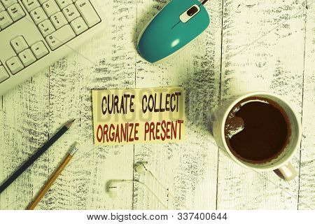 Conceptual hand writing showing Curate Collect Organize Present. Business photo text Pulling out Organization Curation Presenting Technological devices colored reminder paper office supplies. stock photo