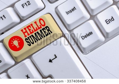 Word writing text Hello Summer. Business concept for season after spring and before autumn where the weather is hot White pc keyboard with empty note paper above white background key copy space. stock photo