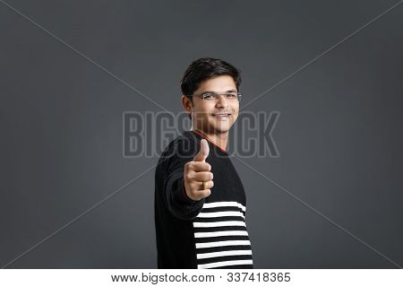 Young indian / Asian man showing thump up stock photo