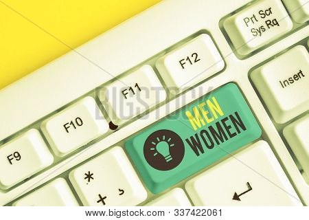 Conceptual hand writing showing Men Women. Business photo showcasing The state where in a boy or a girl turns to be a mature adult White pc keyboard with note paper above the white background. stock photo