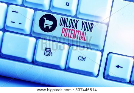 Handwriting text Unlock Your Potential. Concept meaning improve self awareness Skills to Achieve more White pc keyboard with empty note paper above white background key copy space. stock photo