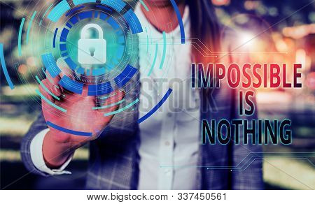 Handwriting text Impossible Is Nothing. Concept meaning Anything is Possible Believe the Realm of Possibility Female human wear formal work suit presenting presentation use smart device. stock photo
