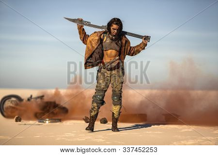 Post-apocalyptic Warrior Woman Outdoors in a Wasteland stock photo