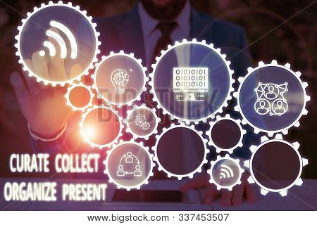 Conceptual hand writing showing Curate Collect Organize Present. Business photo text Pulling out Organization Curation Presenting Male wear formal work suit presenting presentation smart device. stock photo