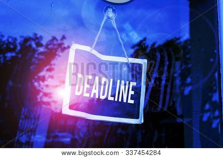 Text sign showing Deadline. Conceptual photo Period of time by which something must be finished or accomplished Empty black board with copy space for advertising. Blank dark board. stock photo