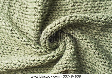 texture of green knitted fabric. Large binding stock photo