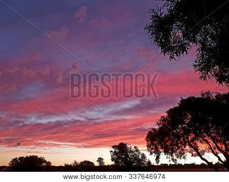 African sunset with pink and purple clouds, photographed in Bloemfontein, South Africa stock photo