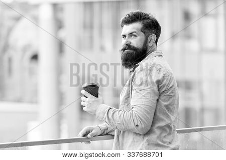 More coffee. morning coffee. Mature hipster with beard. Bearded man relax. brutal hipster with coffee cup. energy charge. Male barber care. copy space. thoughtful man drink take away coffee outdoor. stock photo
