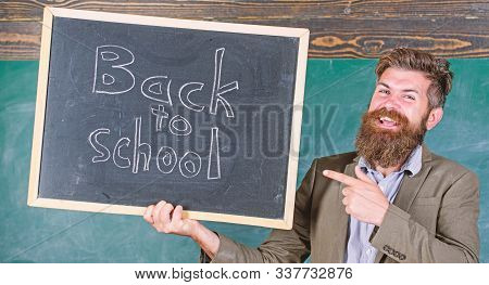 Hiring teachers for new school year. Back to school teachers recruitment. Looking committed teacher complement qualified workforce educators. Man bearded holds blackboard inscription back to school stock photo