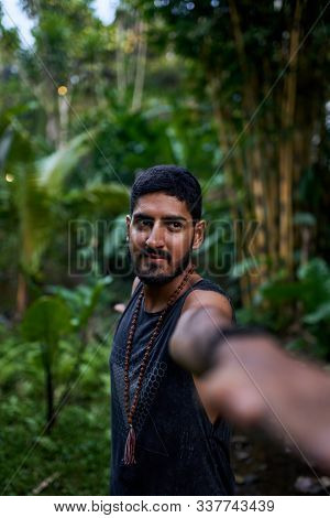 Young healthy attractive male practicing asana yoga in tropical stock photo