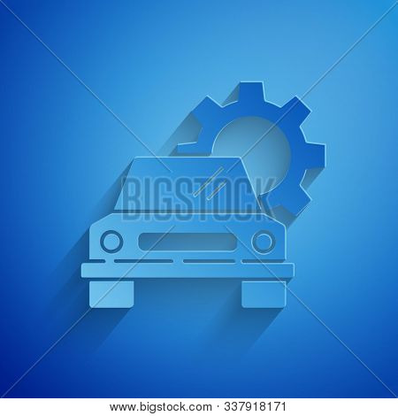 Paper cut Car service icon isolated on blue background. Auto mechanic service. Repair service auto mechanic. Maintenance sign. Paper art style. Vector Illustration stock photo