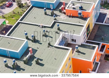 Top view flat roof with air conditioners and hydro insulation membranes on top of a modern apartment. stock photo