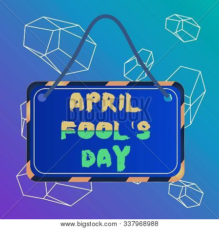 Word writing text April Fool S Day. Business concept for Practical jokes humor pranks Celebration funny foolish Board attached string color black yellow frame empty blank rectangle shape. stock photo