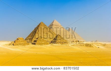 View of pyramids from the Giza Plateau: three Queens' Pyramids the Pyramid of Menkaure the Pyramid of Khafre and the Great Pyramid of Giza (Khufu or Cheops) stock photo