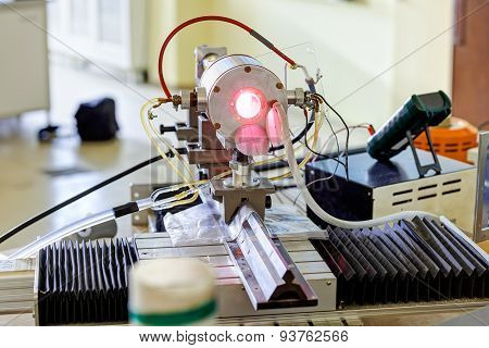 Red laser on optical table in physics laboratory stock photo