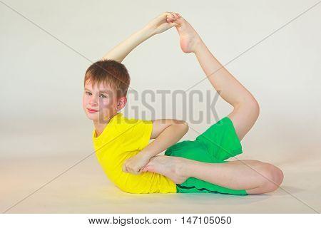 little boy doing yoga on white background stock photo