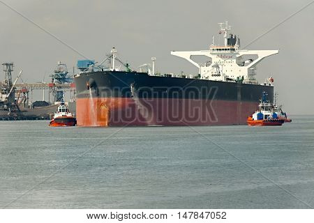 Large crude oil tanker ship coming into port stock photo
