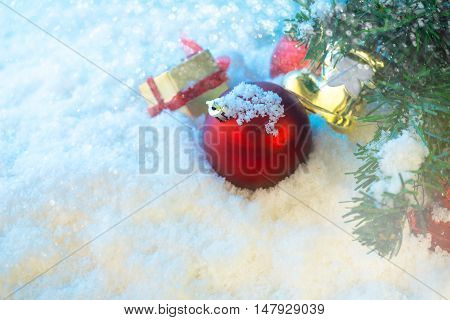 red chrismas ball on snow with chrismas tree abstract background stock photo
