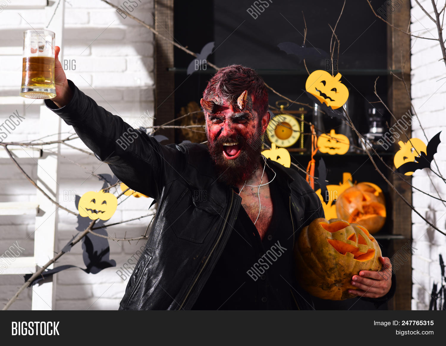 alcohol,ale,autumn,background,bat,beer,beverage,black,blood,carnival,caucasian,celebrate,celebration,concept,cosmetic,dead,decor,demon,devil,evil,face,festival,frighten,halloween,hold,holiday,horns,horror,jack,lantern,man,monster,mug,mystic,o,october,octoberfest,or,orange,party,partying,pumpkin,scary,smile,spooky,symbol,traditional,treat,trick,wear