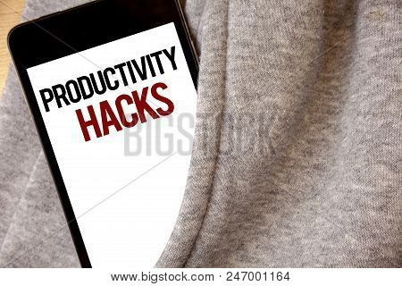 Handwriting text writing Productivity Hacks. Concept meaning Hacking Solution Method Tips Efficiency Productivity Hoar frost color side pocket cell phone be visible black and red letters stock photo