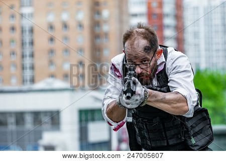 Powerful man Holding Gun. War Action Movie Style - Portrait of a man accessorized as special agent stock photo