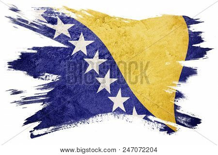 Grunge Bosnia and Herzegovina flag. Bosnian flag with grunge texture. Brush stroke. stock photo