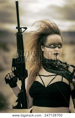 In a post-apocalyptic desert wasteland, two Queens lead their militias against each other. Armed to the teeth, who will win? stock photo
