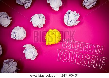 Writing note showing  Believe In Yourself. Business photo showcasing Determination Positivity Courage Trust Faith Belief Pink ground white paper lumps shadow yellow lob outline letters stock photo
