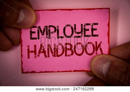 Handwriting text Employee Handbook. Concept meaning Document Manual Regulations Rules Guidebook Policy Code Words written pink paper note red border fingers holding corners message stock photo