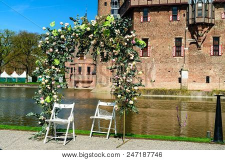Beautiful medieval, fantasy, ancient Holland De Haar castle on sunny day near Utrecht, The Netherlands. stock photo