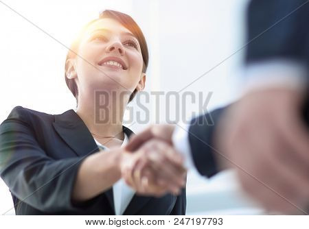 closeup of business woman shaking hands with her business partner. stock photo