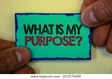 Writing note showing  What Is My Purpose Question. Business photo showcasing Direction Importance Discernment Reflection Greyish backstage man hand retain blue outskirts page showing words stock photo