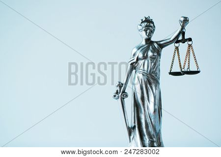 Lady Justice statue in law office. Figurine with blindfold, balance and sword is personification of moral force in judicial system and it's origin is Lustitia, goddess of Justice in Roman mythology stock photo