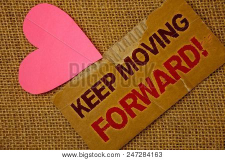 Word writing text Keep Moving Forward Motivational Call. Business concept for Optimism Progress Persevere Move Torn thick paper blood and pigment red texts jute sack pink paper heart stock photo