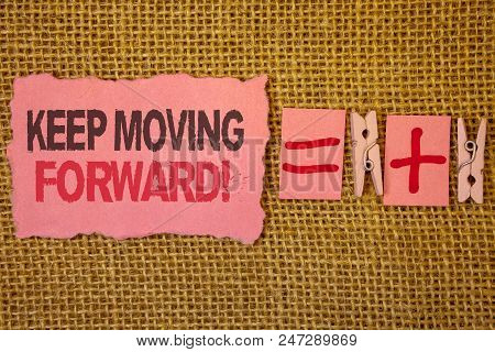 Handwriting text writing Keep Moving Forward Motivational Call. Concept meaning Optimism Progress Persevere Move Jute sacks plus two paper clip equal pink paper with black and red letter stock photo
