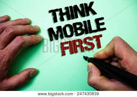 Word writing text Think Mobile First. Business concept for Handheld devises marketing target portable phones first Green background grey shadow important thoughts temple message idea stock photo