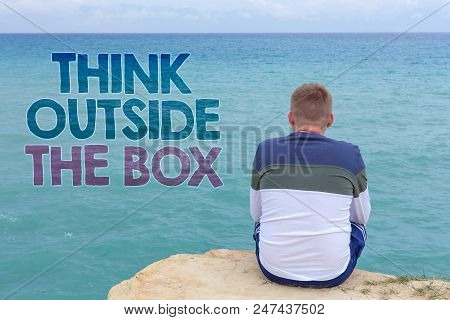 Writing note showing  Think Outside The Box. Business photo showcasing Thinking of new and creative solution leads to success Man sitting sand watching beach Message Relax reflection intention stock photo