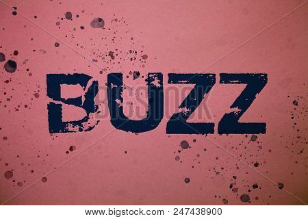 Handwriting text Buzz. Concept meaning Hum Murmur Drone Fizz Ring Sibilation Whir Alarm Beep Chime Ideas messages pink background splatters messy paint communicate feelings stock photo