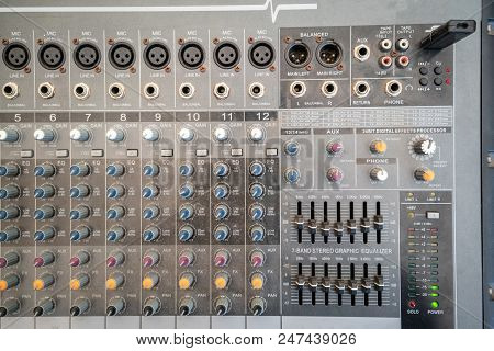 Close up of music mixer equalizer console for mixer control sound device. Sound technician audio mixer equalizer control for background. stock photo