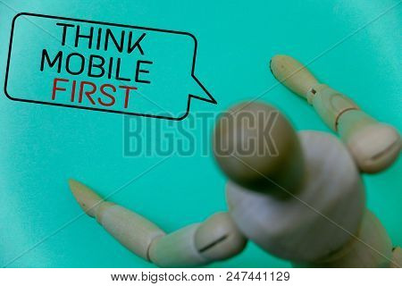 Word writing text Think Mobile First. Business concept for Handheld devises marketing target portable phones first Cyan background robot imaginations idea message template thoughts doll stock photo