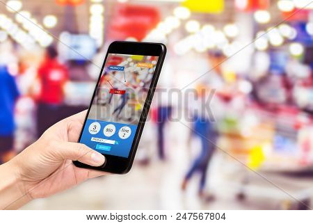 Hand hold mobile phone and using augmented reality ( AR ) app for see promotion sale in supermarket store,Digital lifestyle Technology concept stock photo