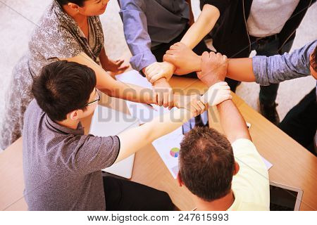 Business People Teamwork Meeting joining hands in office concept, Using Ideas, Charts, Computers, Tablet, Smart devices on business planning the table. stock photo