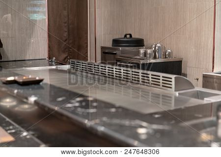 Closed up seasoning ingredient in stainless steel containers on cabinet cart in cooking area for Teppanyaki chef convenience. stock photo