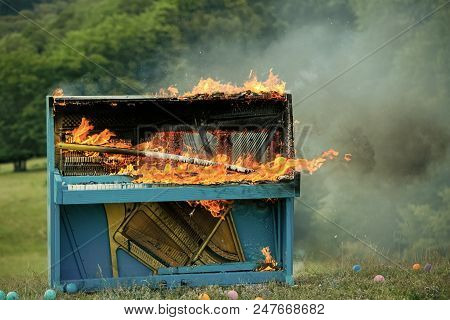 Burning piano. Grunge instrument, burning piano, musical style. grunge instrument of old piano on fire stock photo