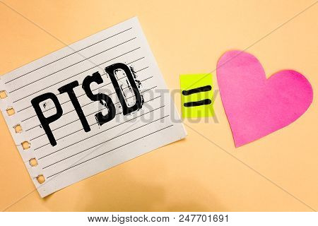 Conceptual hand writing showing Ptsd. Business photo showcasing Post Traumatic Stress Disorder Mental Illness Trauma Fear Depression Love equation memory thought orange heart lovely art papers stock photo