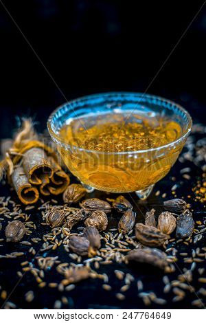 Ayurvedic home remedy for Stuffy Nose : Cardamom,cinnamon,cumin and black pepper with salt with warm water. stock photo