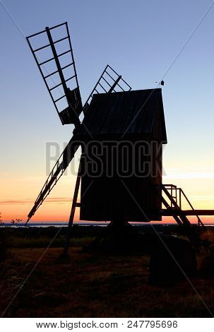 Windmill on the Swedish island Oland in silhouette at sunset. stock photo