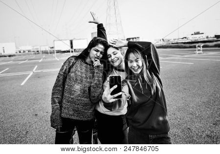 Group of teenage friends hanging out stock photo