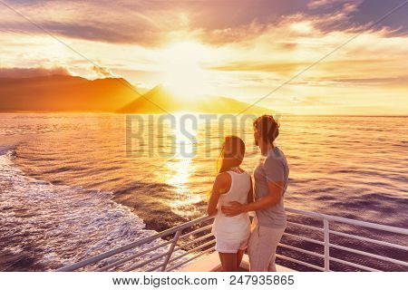 Travel cruise ship couple on sunset cruise in Hawaii holiday. Two tourists lovers on honeymoon trave
