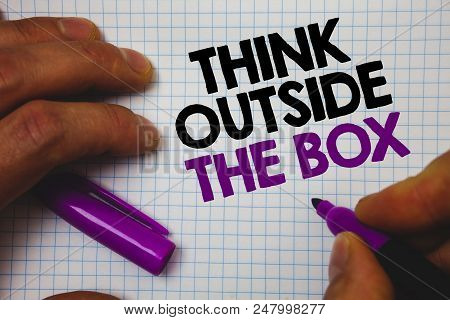 Text sign showing Think Outside The Box. Conceptual photo Thinking of new and creative solution leads to success Man hold holding purple marker notebook page messages intentions ideas stock photo